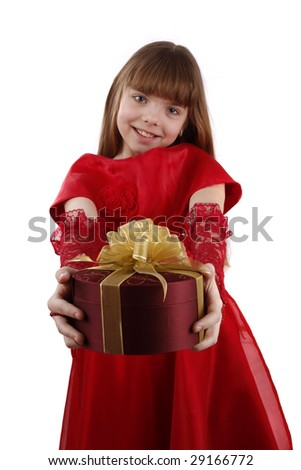 Beautiful girl is giving the gift. Female with present. Attractive lady holding purple box with gold ribbon. Isolated over white background. - stock photo