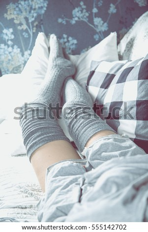Beautiful girl is relaxing on the sofa, cozy concept