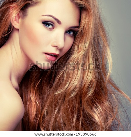 Beautiful girl, isolated on a light - grey background, emotions, cosmetics - stock photo