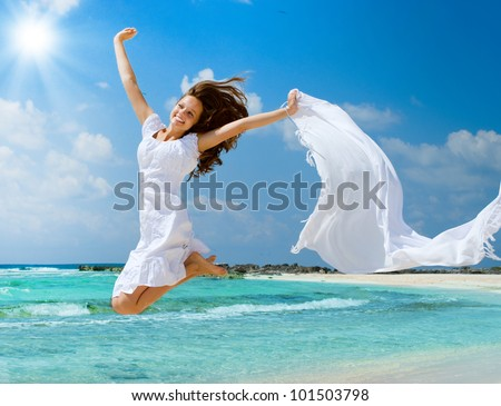 Beautiful Girl Jumping on The Beach. Vacation Concept