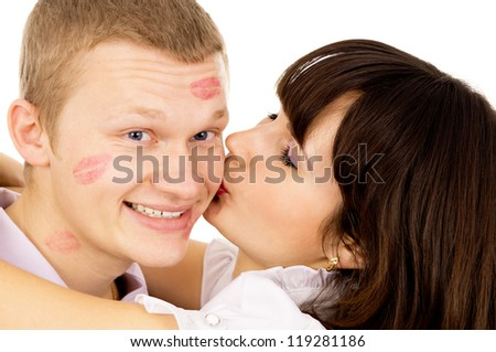 beautiful girl kisses her boyfriend isolated on white background