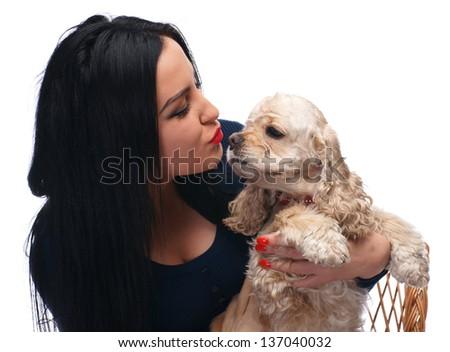 Beautiful girl kissing american spaniel on white background - stock photo