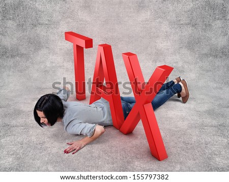 Beautiful girl lay under a big red tax - stock photo