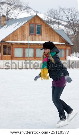 beautiful girl learns to skating on the skate - stock photo
