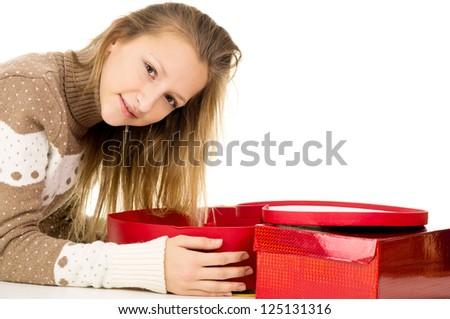 beautiful girl lies beside gifts - stock photo