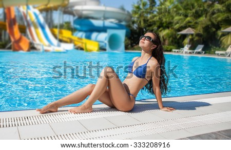 beautiful girl lies on the backdrop of water slides. water Park