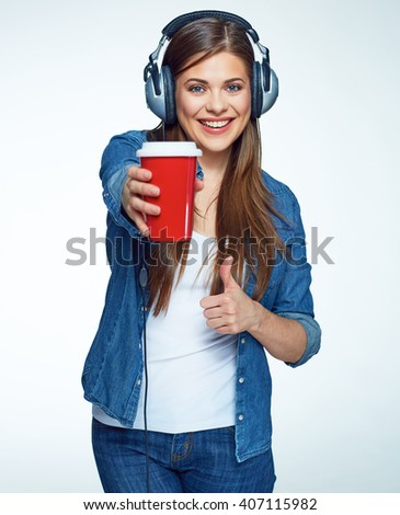 Beautiful girl listening music with coffee glass. Smiling young woman.
