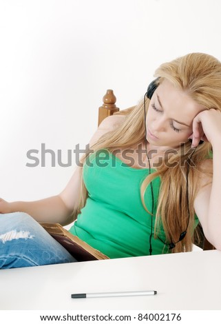 beautiful girl listening to music and learn.Back to school. - stock photo
