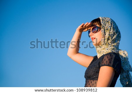 Beautiful girl looking ahead or away happy and smiling - stock photo