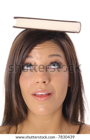 beautiful girl looking at book - stock photo