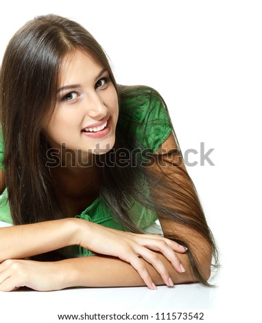 Beautiful girl lying down and happy smiling. Isolated on white background - stock photo