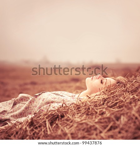 beautiful girl lying in grass resting - stock photo