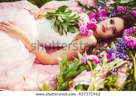 beautiful girl lying on green grass in the woods