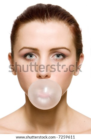 Beautiful  girl making a bubble from chewing gum
