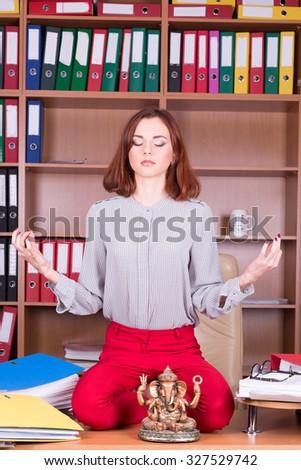 beautiful girl meditate in office - stock photo