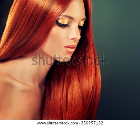 Beautiful girl model with long straight red hair . Healthy well-groomed hair .  - stock photo