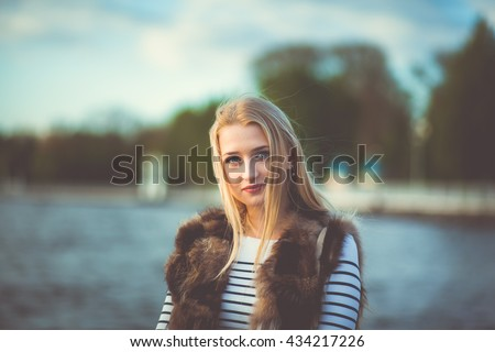 beautiful girl near pond - stock photo