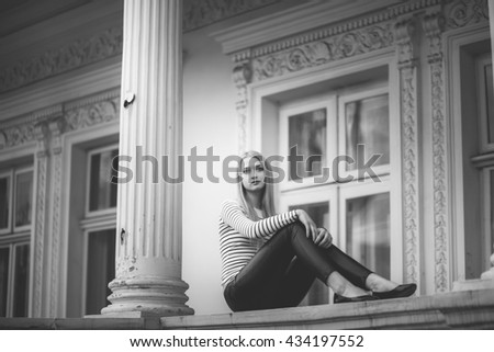 beautiful girl near the house with columns - stock photo