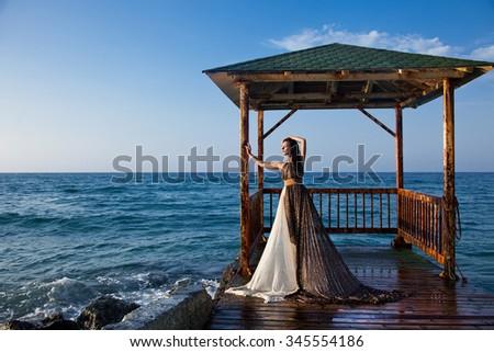 beautiful girl near the sea - stock photo