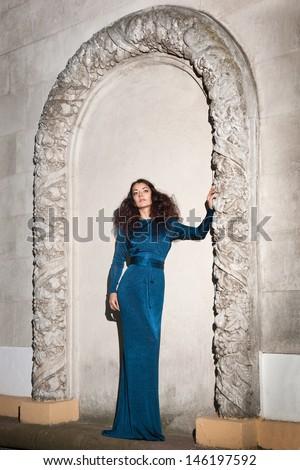 beautiful girl near the wall - stock photo