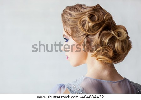 Beautiful girl of the bride from the back - stock photo