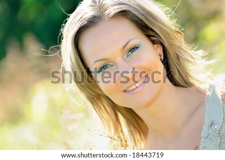 beautiful girl on field in summer
