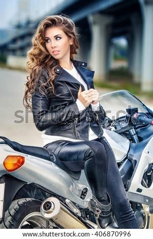 Beautiful girl on motorcycle - stock photo