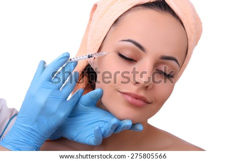 Beautiful girl on rejuvenation procedure on an isolated white background. - stock photo