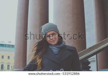 beautiful girl on the background of the granite columns.