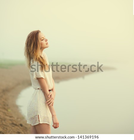 beautiful girl on the beach alone - stock photo