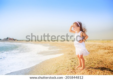 beautiful girl on the beach looking into the distance, wind, rest, happiness