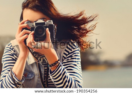 beautiful girl on the beach sitting on the sand photographs - stock photo