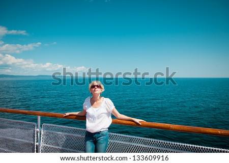 Beautiful girl on the deck - stock photo