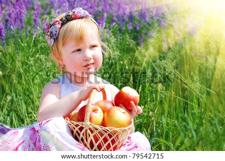 Beautiful girl  on the meadow - stock photo