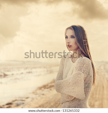 beautiful girl on the road. vintage photo in golden tones - stock photo