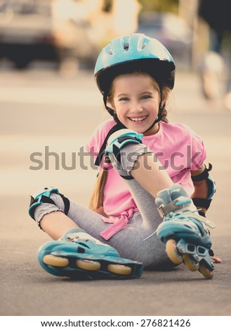 beautiful girl on the rollers in helmet and protection - stock photo