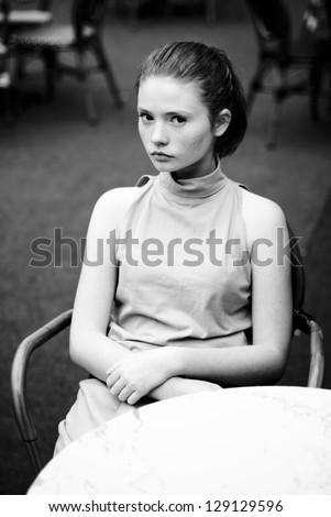 beautiful girl on the street of the old city. black and white retro photos - stock photo