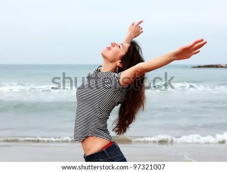 Beautiful girl on the winter beach - stock photo