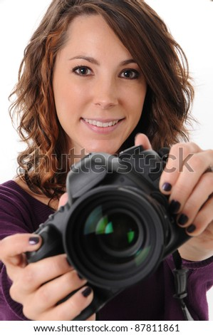 Beautiful Girl Photographer in Studio with Camera