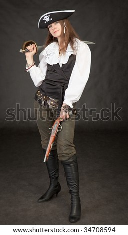 Beautiful girl - pirate with sabre and pistol on a black background