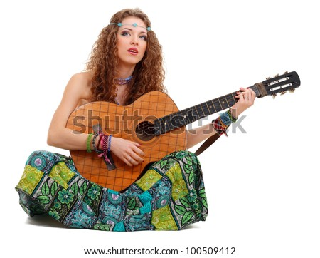 Beautiful Girl playing guitar on white background in hippie outfit isolated - stock photo
