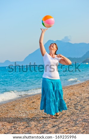 beautiful girl playing on the beach ball - stock photo