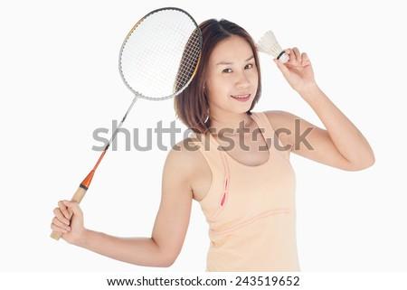 beautiful girl playing sport badminton  - stock photo