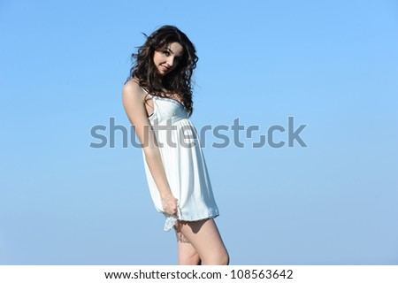 beautiful girl playing with her white dress - stock photo