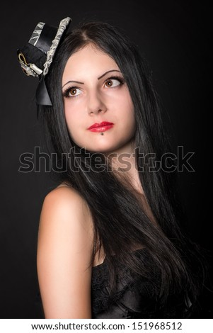 Beautiful girl portrait studio shot. Gothic style clothing, Lots of copy space - stock photo