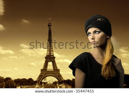 beautiful girl portrait with tour eiffel on the background - stock photo