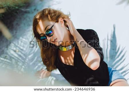 beautiful girl posing on the beach near palm trees - stock photo
