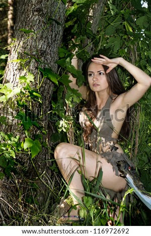 beautiful girl posing with a loincloth on the nature