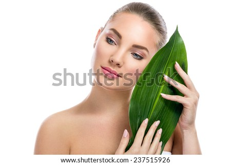 Beautiful girl posing with green leaf, nature beauty - stock photo