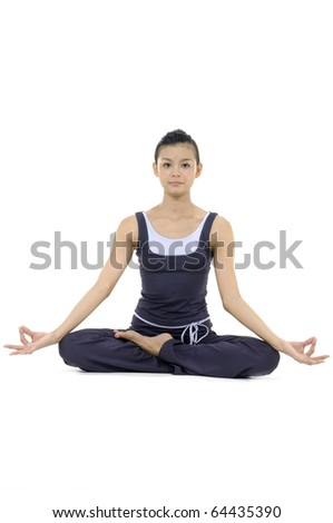 Beautiful girl practicing yoga on isolated white background - stock photo